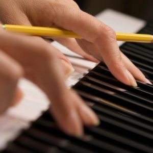 Woman's Fingers on Digital Piano Keys